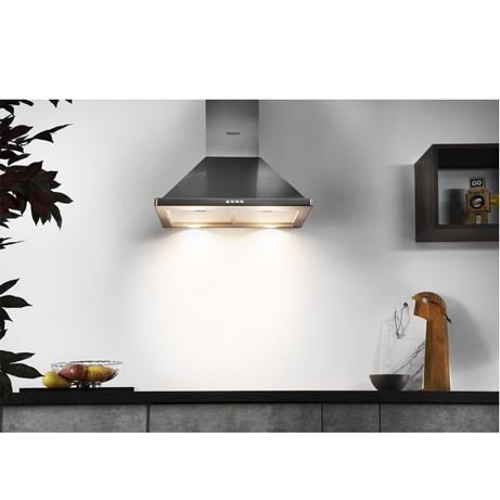 HOTPOINT CHIMNEY COOKER HOOD WITH THE LIGHTS ON