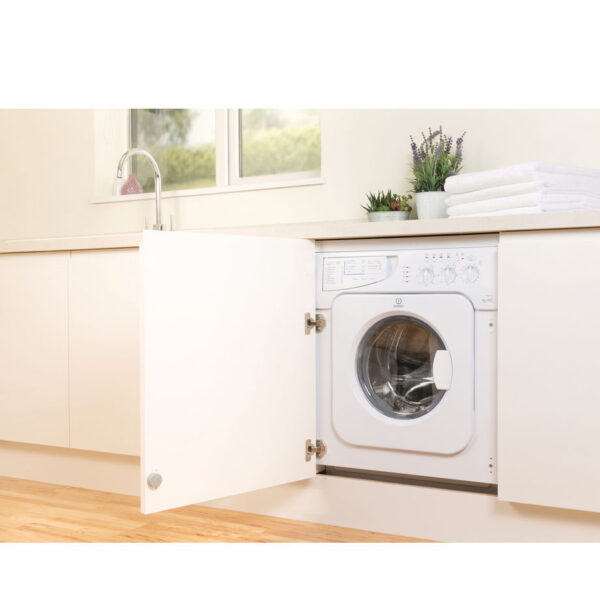 Integrated Washer Dryer fitted with the cupboard door open